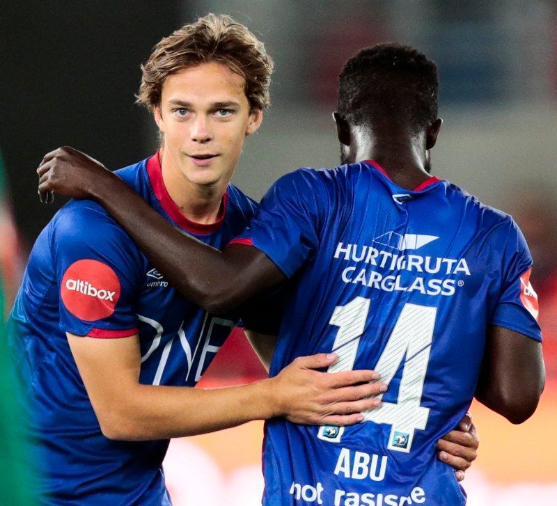 GODE MINNER: Felix Horn Myhre og Mohammed Abu jubler etter et mål mot Tromsø i Eliteserien. Foto: Lise Åserud / NTB scanpix