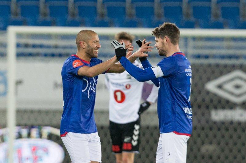 Amin Nouri og Daniel Fredheim Holm trives på høyresida (Foto: Fredrik Hagen / NTB scanpix)